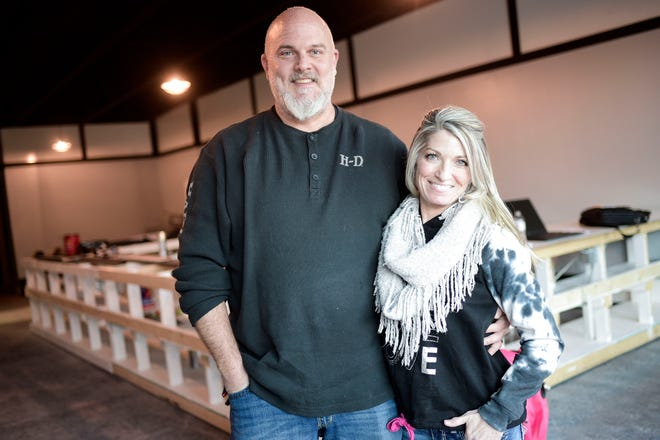 Owners Jason and Michelle Able pose for a photo inside their upcoming shop, South Knox Nutrition, on Sevier Ave. in Knoxville, Tenn. on Friday, Feb. 29, 2021. The smoothie and tea shop plans to open near the end of the month.