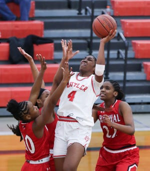 Butler's Tiarra East (4) shoots against the Manual defense during their game at Butler High School on Feb. 2, 2021.