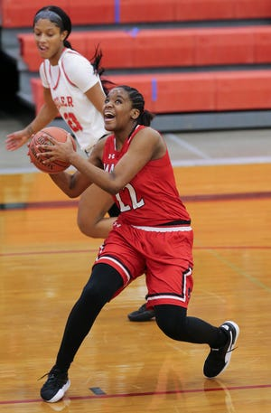 Manual's Daisha White (22) drove to the basket against Butler during their game at Butler High School on Feb. 2, 2021.