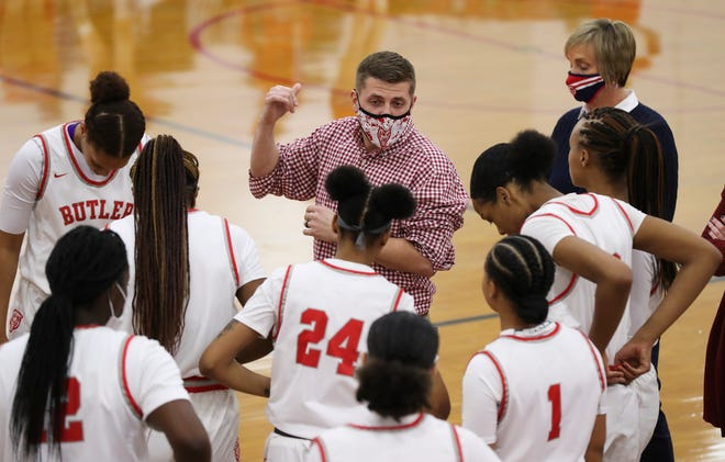 Butler head coach Wyatt Foust instructed his team against Manual during their game at Butler High School on Feb. 2, 2021.