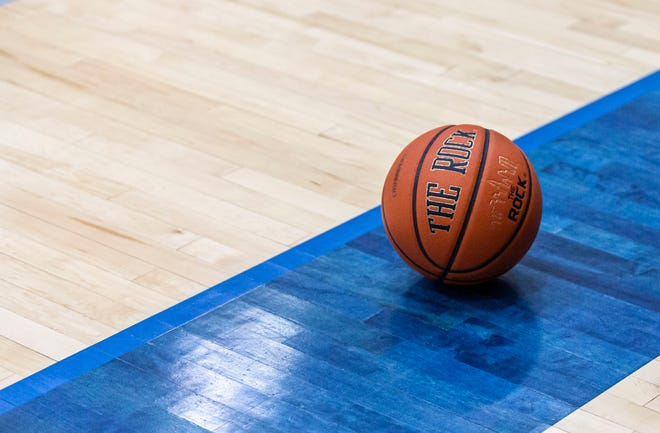 A basketball rests on the court during a high school basketball game on Tuesday, Feb. 2, 2021.