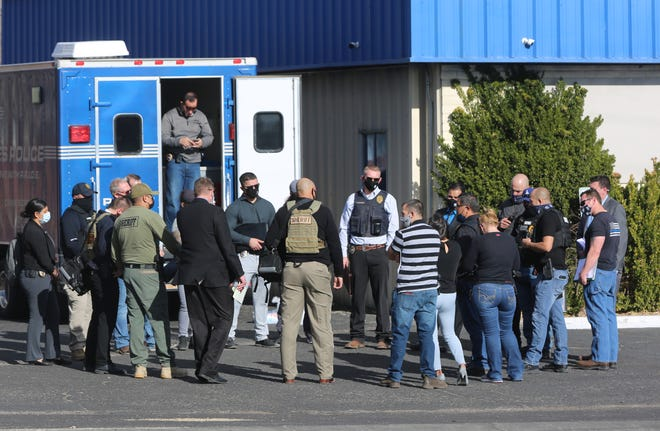 Members of a task force that investigates police shootings gather  Wednesday Feb. 3, 2021, near the Doña Ana Park Apartments in Las Cruces.