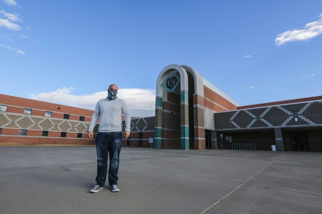 Jim Schapekahm, principal of Oñate High School, is pictured in front of the school on Wednesday, Feb. 3, 2021.