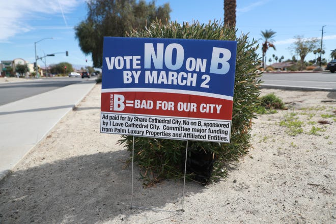 A sign encouraging Cathedral City, Calif. voters to vote against Measure B sits on the side of McCallum Way on Wednesday, February 3, 2021. The ballot initiative will allow voters to decide on the future of short-term rentals in the city during a March 2 special election.