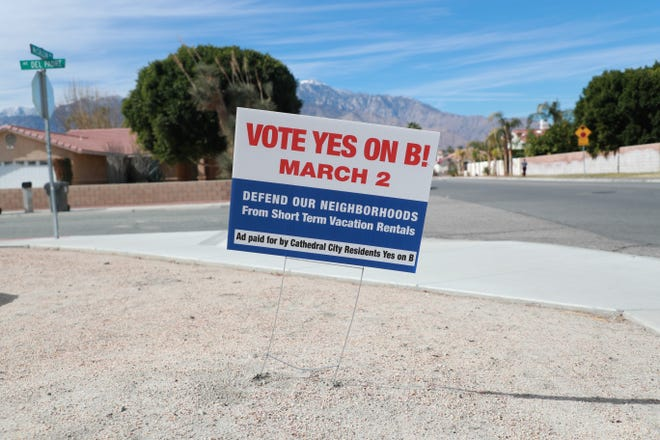 A sign encouraging Cathedral City, Calif. voters to choose in favor of Measure B sits on the side of McCallum Way on Wednesday, February 3, 2021. The ballot initiative will allow voters to decide on the future of short-term rentals in the city during a March 2 special election.