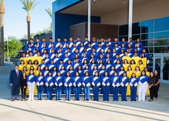 The band at Indio High School received a $5,000 grant to pay for musical instruction.