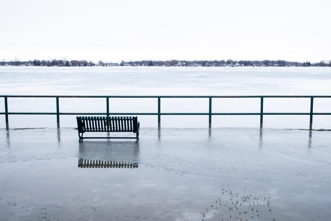 Water from the St. Clair River spills into the Marine City Park Wednesday, Feb. 3, 2021, in Marine City.
