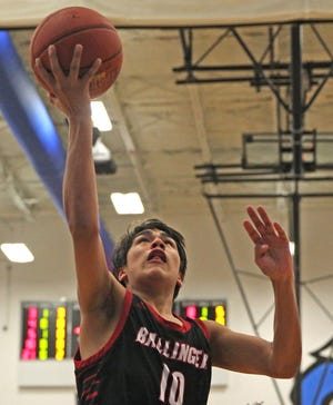 Ballinger's Jon Delgado lays the ball in during a game against TLCA on Tuesday, Feb. 2, 2021.