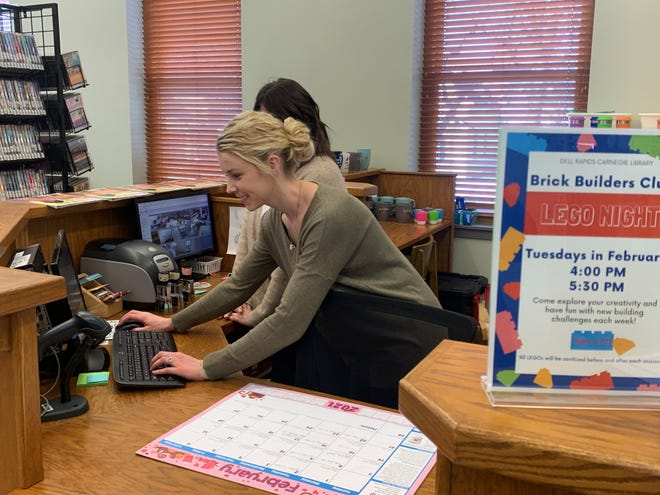 Dell Rapids Carnegie Library director Brittany Moeller works alongside Kinsey Griffin on Wednesday, Feb. 2, 2020.