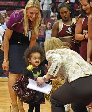 Florida State interim head coach Brooke Wyckoff with daughter Avery