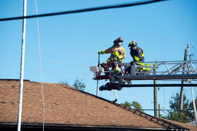 Martin County Fire Rescue work to quell a house fire that displaced two adults and their pets Wednesday, Feb. 3, 2021, on Southeast Washington Street in Martin County.