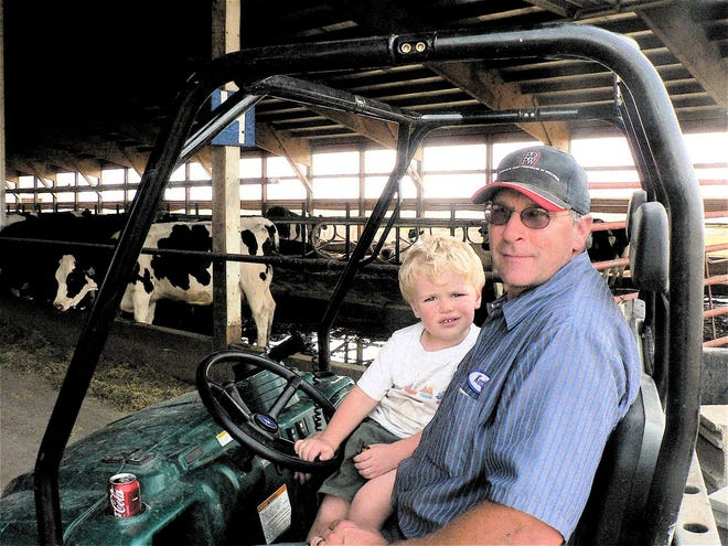 "Dairy farmer Kenton Holle on his four-wheeler met John Oncken in the summer of 2008 with a ""good to see you"" greeting."