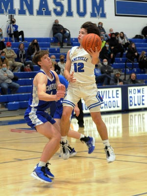 Drew Doyle takes a shot during Zanesville's 47-43 loss to visiting Cambridge on Feb. 2 at Winland Memorial Gymnasium.