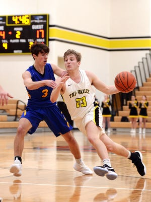 Luke Lyall dribbles up court against West Muskingum's Aiden Lemity during Tri-Valley's 69-56 win on Feb. 2 in Dresden. Lyall scored a game-high 28 points as the Scotties scored 13 of the final 15 points.