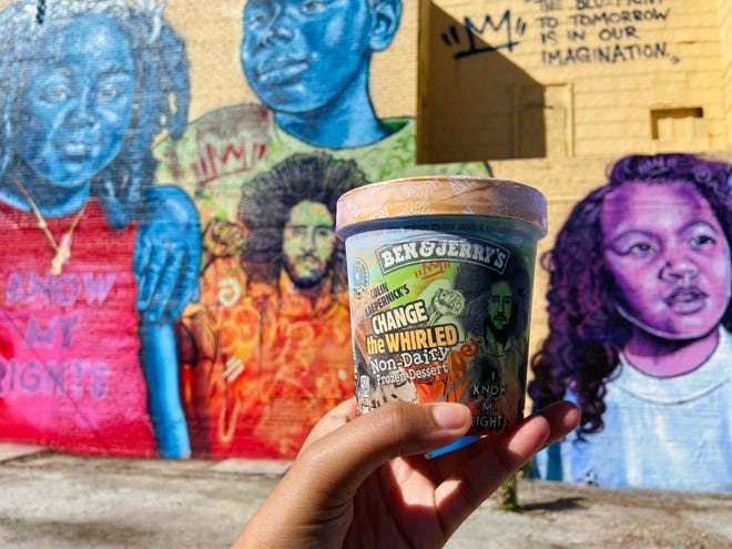 Ben & Jerry's Change the Whirled pint of ice cream in front of the Change the Whirled mural in Old West Tampa.