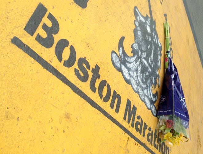 Flowers rest at the finish line of the Boston Marathon after the verdict in the penalty phase of the trial of marathon bomber Dzhokhar Tsarnaev, Friday, May 15, 2015, in Boston.