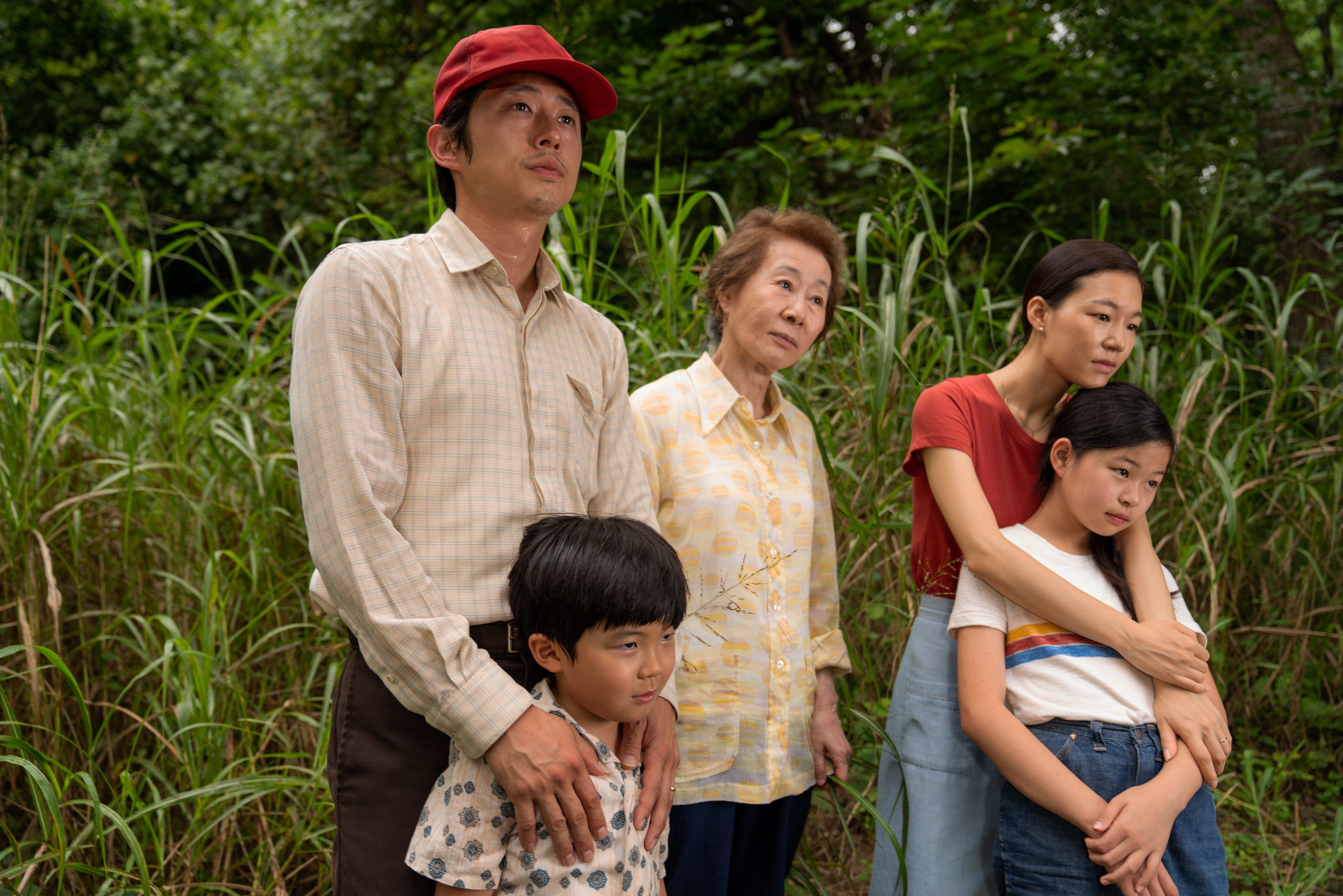 "Steven Yeun, left, Alan S. Kim, Yuh-jung Youn, Yeri Han and Noel Cho star in ""Minari,"" a heartwarming story about Korean-American immigrants."