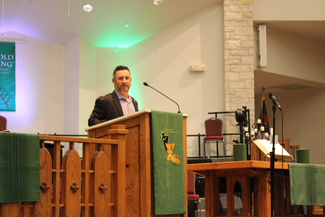 Round Rock Mayor Craig Morgan speaks at the 13th annual Mayor's Prayer Breakfast on Thursday morning at First United Methodist Church.