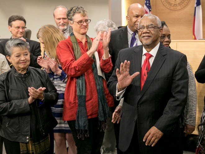 Travis County Commissioner Ron Davis, right, is congratulated by Commissioner Margaret Gomez, left, and County Judge Sarah Eckhardt at the Travis County Commissioners Court on Dec. 20, 2016, during a resolution honoring Davis for retiring after 18 years of service representing Precinct 1.