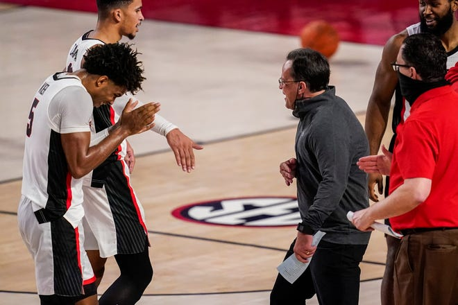 Dec 22, 2020; Athens, Georgia, USA; Georgia head coach Tom Crean reacts with guard Justin Kier (5) and forward Toumani Camara (10) during a timeout in the second half against the Northeastern Huskies at Stegeman Coliseum. Dale Zanine-USA TODAY Sports