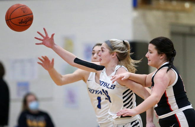 CVCA's Nina Shaffer, left, chases down a loose ball ahead of Orrville's Ella Gonzales during the first half of a basketball game, Wednesday, Feb. 3, 2021, in Cuyahoga Falls, Ohio. [Jeff Lange/Beacon Journal]