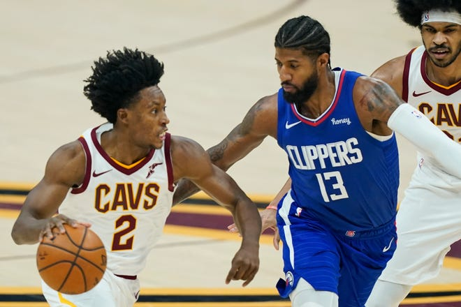 Cavaliers guard Collin Sexton (2) drives against Los Angeles Clippers forward Paul George (13) during Wednesday night's game in Cleveland. Former Cavs and current Clippers coach Tyronn Lue isn't surprised by the improvement shown by Sexton and the Cavs under coach J.B. Bickerstaff. [Tony Dejak/Associated Press]