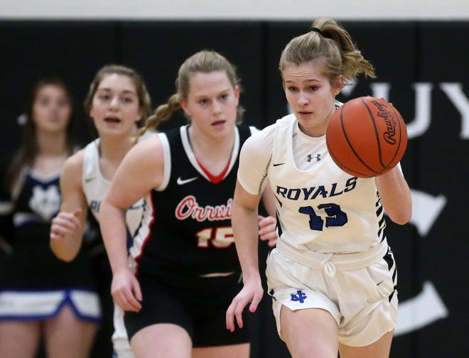 CVCA's Kylie Bettinger, right, takes the ball down the court during the Royals' 64-26 win over Orrville on Wednesday night. [Jeff Lange/Beacon Journal]