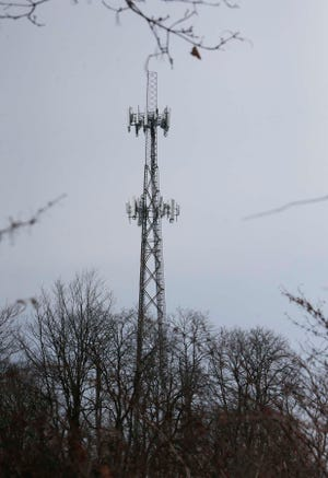 A private dispute between two telecommunications companies over a cell tower off Wilson Street is jeopardizing cell service for the heart of Akron.