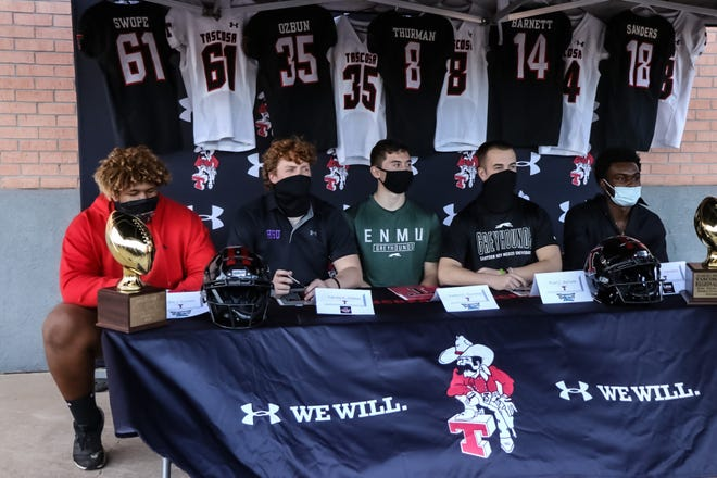 From Left: Tascosa seniors Ollie Swope, Carson Ozbun, Kaden Thurman, Ryan Barnett and Darius Sanders all sign their respective letters of intent during a Wednesday afternoon ceremony on National Signing Day.