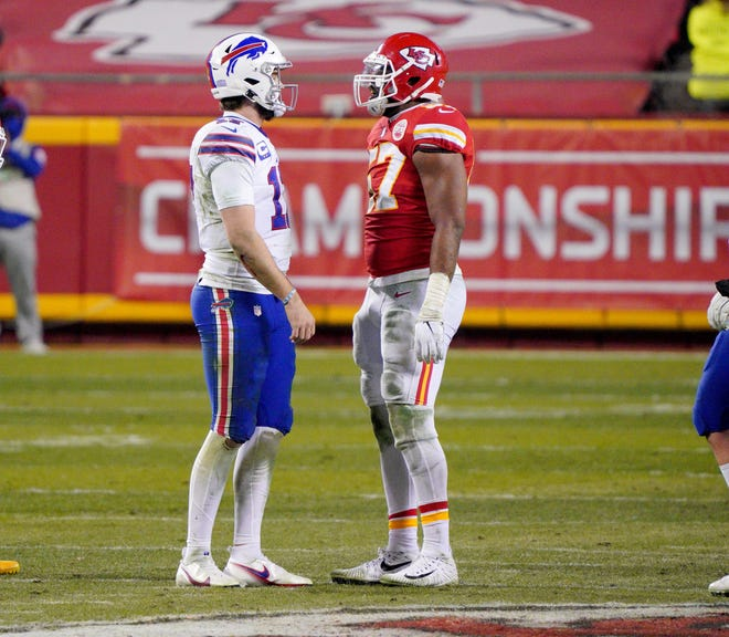 Buffalo Bills quarterback Josh Allen and Kansas City Chiefs defensive end Alex Okafor exchange words after a play in the NFC Conference Championship. Okafor is the lone Texas ex playing in Sunday's Super Bowl.