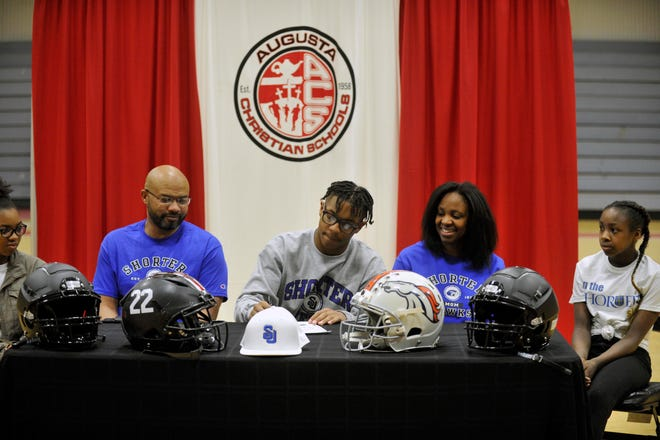 Terrence Vandiver, Jr. (center) signs his NLI to play football at Shorter University. Vandiver was the first football player to sign an NLI since 2017 and will go down as one of the top football players in Augusta Christian history. [WYNSTON WILCOX/THE AUGUSTA CHRONICLE]