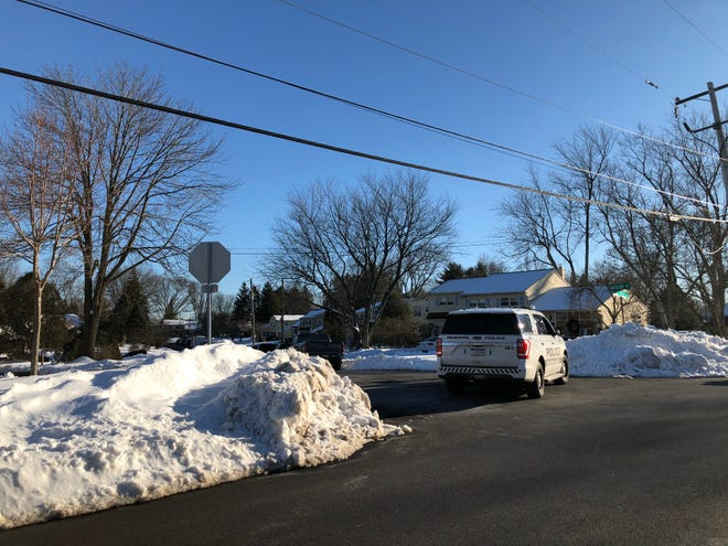 A Central Bucks Regional Police car sits at the intersection of Marion Road and West Peace Valley Road Wednesday afternoon. Police said there was an armed barricaded man in a home in the first block of Valley View Road.