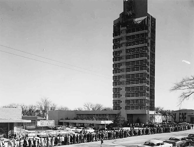 The line of visitors stretched down Dewey Avenue as hundreds of people waited to finally see inside the Price Tower on Feb. 10, 1956.