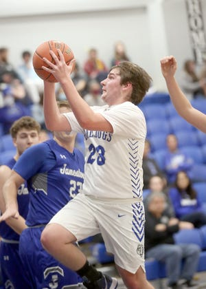 New Franklin's Tanner Bishop drives the middle of the lane in the first half Tuesday night against Jamestown. Bishop finished the game with eight points, helping the Bulldogs beat Jamestown 40-32.