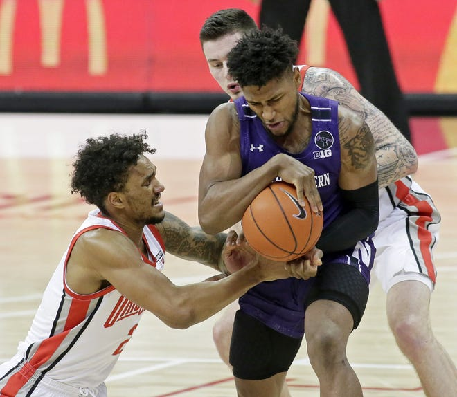 Musa Jallow, fighting for a loose ball with Northwestern's Boo Buie on Jan. 13, contributes for Ohio State in defensive areas that don't show up on the stat sheet.