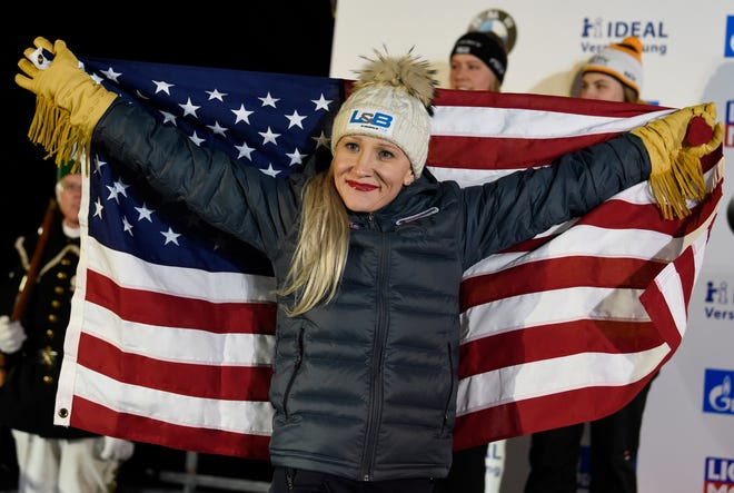 Gold medalist Kaillie Humphries of the United States celebrates during the medal ceremony for the two-woman bobsled competition at the Bobsleigh and Skeleton World Championships in Altenberg, Germany, in February 2020.