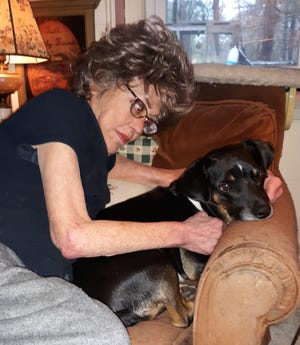 Columnist Saralee Perel and her dog. Mendel, share a cuddle as they discuss what he is looking for in a canine companion/ [BOB DALY]