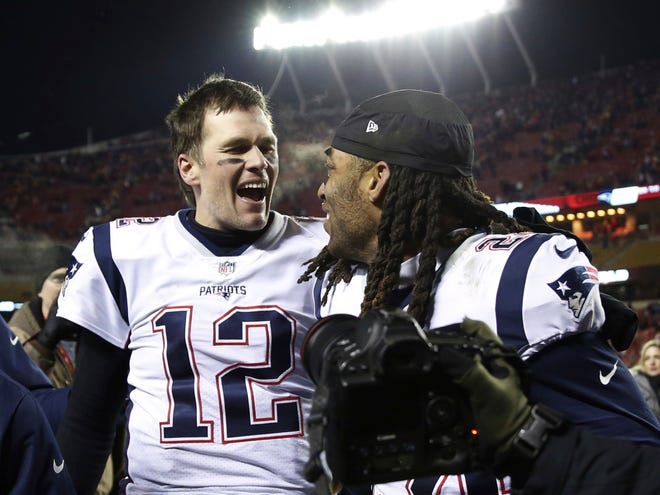 New England Patriots quarterback Tom Brady (12) celebrates with cornerback Stephon Gilmore (24) after defeating the Kansas City Chiefs in the AFC Championship in January 2019 in Kansas City, Mo. Brady and the Tampa Bay Buccaneers face the Chiefs again in Super Bowl LV on Sunday in Tampa, Fla.