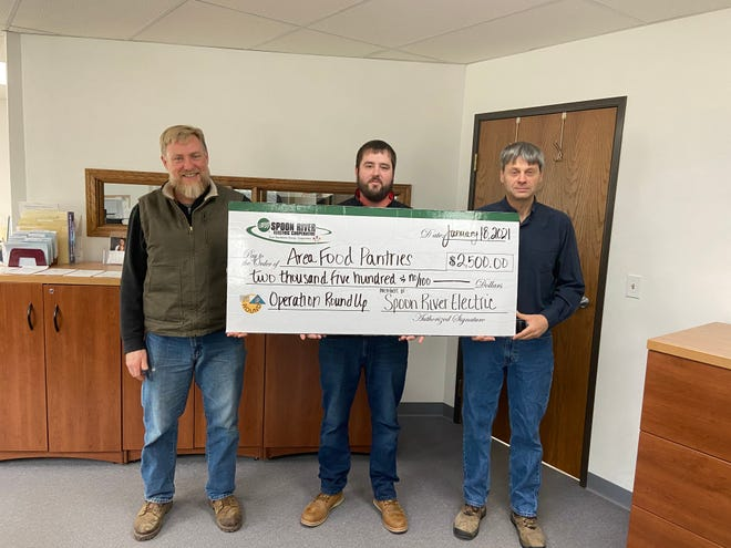 Pictured from the left are employees of Spoon River Electric,Josh DeWees, David Whitehurst and Mark Balbinot. The Spoon River Electric Operation Round Up Committee recently donated $2,500 to five local food pantries within their service area.