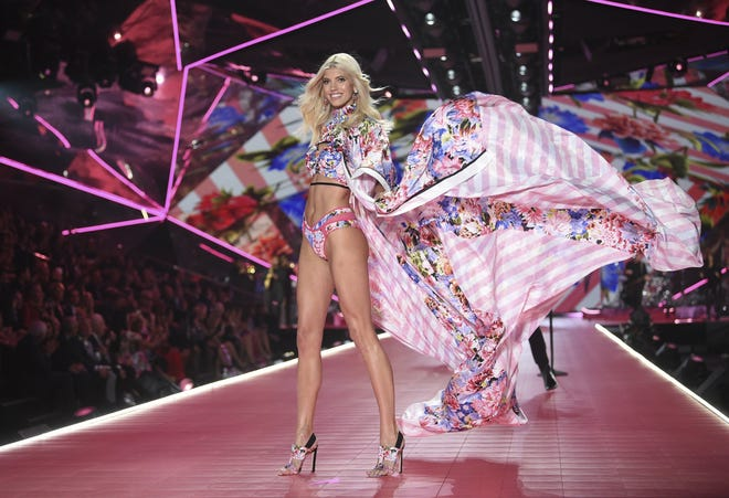 Model Devon Windsor walks the runway during the 2018 Victoria's Secret Fashion Show in New York. L Brands said Thursday that it plans to spin off Victoria's Secret into a separate company.