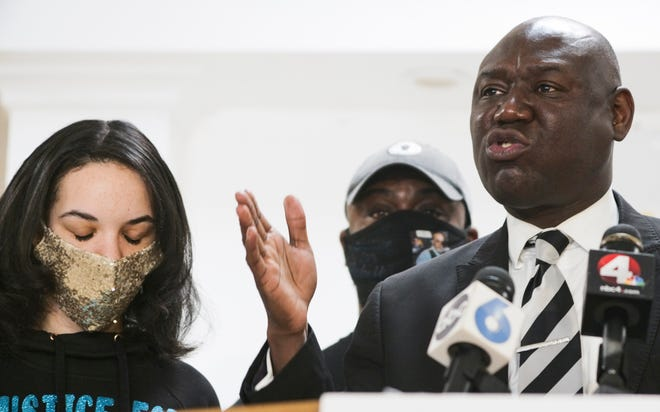 Nationally known civil rights attorney Ben Crump has filed a lawsuit against Ohio State on behalf of victims who have alleged sexual abuse by team doctor Richard Strauss. In this file photo, Crump, right, speaks, as Karissa Hill, left, daughter of Andre Hill, listens during a press conference following the indictment of former Columbus police officer Adam Coy in Hill's December 2020 police shooting death.