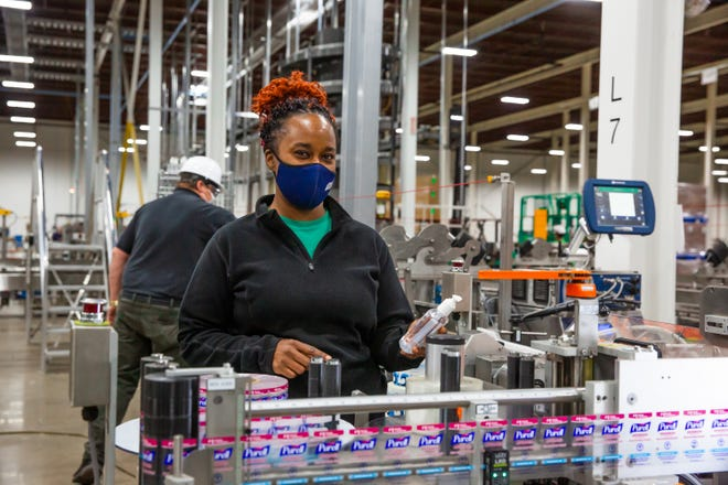 GOJO employee Nicole Goolsby works on the assembly line at the company's plant in Wooster.
