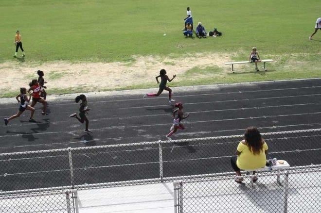 Children participate in track and field events in a Police Athletic League program in 2013 at the New Smyrna Beach Sports Complex.