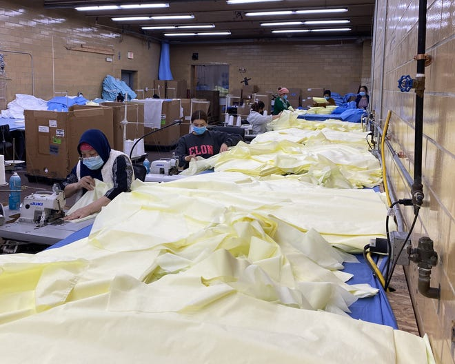 Employees at Genesis Disposables, LLC, work to make disposable gowns and other items for hospitals, medical clinics and nursing homes. The company currently employs 30 people and expects to add more employees by the end of the year, with the help of a $400,000 grant from the Empire State Development Corporation.