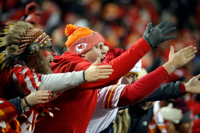 """Kansas City Chiefs fans chant and do the tomahawk chop. The Kansas City Chiefs have since barred headdresses and war paint amid the nationwide push for racial justice, but its effort to make its popular """"war chant"""" more palatable is getting a fresh round of scrutiny from Native American groups as the team prepares to make its second straight Super Bowl appearance."""