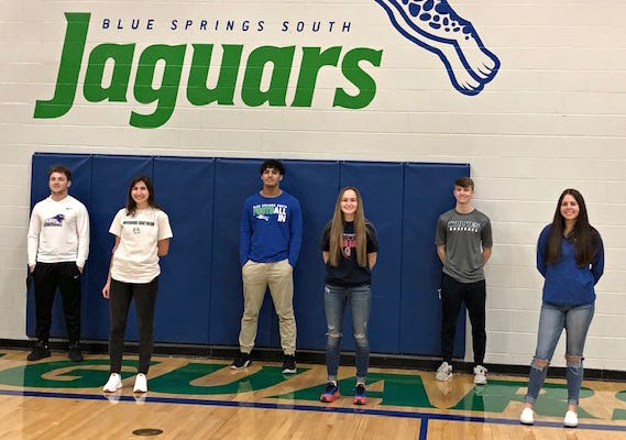 Eight Blue Springs South senior student-athletes signed their letters of intent to extend their athletic careers in college Wednesday in the high school's gymnasium. Those taking part in the socially distanced ceremony included, from left to right (listed by name, sport, college): Ethan Watson, football, Southwest Baptist University; Braylee Childers, women's soccer, Missouri Southern; Aden Birdwell, football, University of Central Missouri; Hannah Smith, women's basketball, Southwestern (Iowa) Community College; Keaton Latlip, baseball, Metropolitan Community College (Maple Woods); and McKenna Lester, softball, Kansas City Kansas Community College. Not pictured are Dylan Reed and Kendall Outlaw, who both signed with Westminster College to play football.