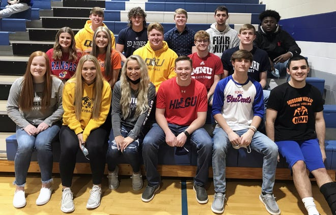 The members of the Grain Valley High School 2021 national signing class, took a deep breath, removed their masks and posed for a group picture Wednesday morning in the high school gymnasium. The class includes The Examiner's Offensive and Defensive Football Players of the Year, Cole Keller (second row right) and Hunter Newsom (back row second from left), and Raena Childers (second row, far left), the first Eagles soccer player to sign with a Power 5 school as she will join her sister Rylan at the University of Kansas.