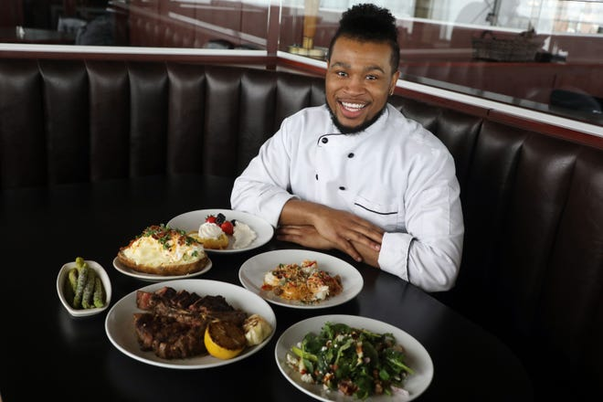 Bartholomew Manning, the executive chef at Martini's Grille, is shown Thursday with the restaurant's Valentine's Day offering featuring a 32 ounce porterhouse steak for two, a ricotta cheese and baccio cheese stuffed ravioli with a toasted fennel and lobster cream sauce, a loaded baked potato with a white cheddar cheese bechamel sauce, Martini's winter spinach salad with a warm bacon vinaigrette with apples, pears and pecans, roasted asparagus and for dessert a white chocolate molten lava cake with orange vanilla whipped cream and fresh winter berries at the Burlington restaurant.