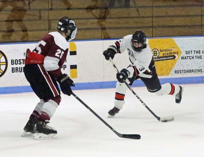 Gardner/Murdock senior defenseman Phil Quinn (3) tries to capitalize on an opportunity to turn defense into offense by putting a shot on goal during a recent game against Fitchburg/Monty Tech at Gardner Veterans Arena.
