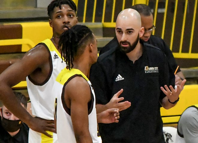 Garden City Community College's Head Coach Cole Dewey talks with players during a time out Wednesday as the Broncbusters face Coffeyville at Perryman Athletic Complex. Dewey is in his first year at GCCC.